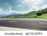 asphalt road and mountain under ... | Shutterstock . vector #667312993
