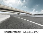 asphalt highway under the blue... | Shutterstock . vector #667313197