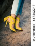 woman legs in leather yellow ... | Shutterstock . vector #667362247