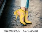 woman legs in leather yellow ... | Shutterstock . vector #667362283