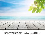 empty wooden table and palm... | Shutterstock . vector #667363813