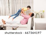 happy indian father playing... | Shutterstock . vector #667364197