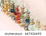 a row of perfume bottles in...   Shutterstock . vector #667426693