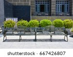 row of wrought iron benches   Shutterstock . vector #667426807