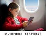 adorable little girl traveling... | Shutterstock . vector #667545697