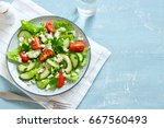 green salad with sliced avocado ... | Shutterstock . vector #667560493