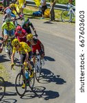 Small photo of COL DU GRAND COLOMBIER,FRANCE-JUL 17: Froome in Yellow Jersey riding in a group of cyclists on the road to Col du Grand Colombier in Jura Mountains during the stage 15 of Tour de France 2016.