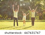 happy family in park with hands ... | Shutterstock . vector #667631767