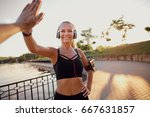 Runner Girl Giving High Five I...