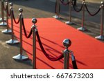 long red carpet between rope... | Shutterstock . vector #667673203