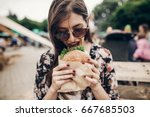 stylish hipster woman holding... | Shutterstock . vector #667685503