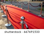 long red carpet between rope... | Shutterstock . vector #667691533