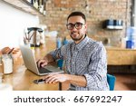 happy man working on laptop. in ... | Shutterstock . vector #667692247