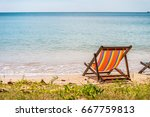 colorful beach chair on... | Shutterstock . vector #667759813