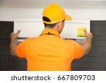 air conditioning technician   Shutterstock . vector #667809703