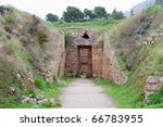 Small photo of The entrance to Aegisthus Tholos Tomb in the ancient Mycenae, Greece