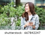 young asian girl using smart... | Shutterstock . vector #667842247