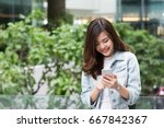 young asian girl using smart... | Shutterstock . vector #667842367