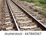 railway track with green tree... | Shutterstock . vector #667860367