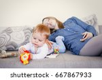 exhausted mother and baby on... | Shutterstock . vector #667867933