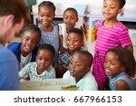 teacher reading book to... | Shutterstock . vector #667966153