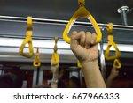 woman hand holding onto a...   Shutterstock . vector #667966333