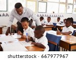 teacher stands helping... | Shutterstock . vector #667977967