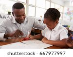 teacher helping elementary... | Shutterstock . vector #667977997