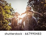 happy family in nature. parents ... | Shutterstock . vector #667990483