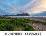seaside oregon beach at sunset | Shutterstock . vector #668002693