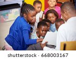 teacher showing kids a book... | Shutterstock . vector #668003167