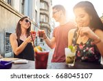 friends at cafe drinking and... | Shutterstock . vector #668045107