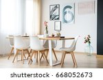pink roses in big glass vase... | Shutterstock . vector #668052673