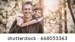 portrait of happy father... | Shutterstock . vector #668053363