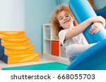 happy boy using blue disc swing ... | Shutterstock . vector #668055703