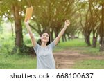 young asian woman holding book... | Shutterstock . vector #668100637