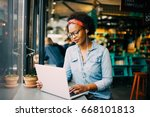 focused young african woman... | Shutterstock . vector #668101813