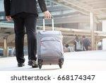 businessmen drag luggage to... | Shutterstock . vector #668174347