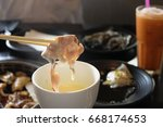 pork in to sauce cheese   Shutterstock . vector #668174653