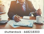 business man hand pointing to... | Shutterstock . vector #668218303