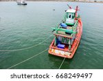 fishing boat parked in the dock.... | Shutterstock . vector #668249497