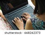 closeup of young woman using... | Shutterstock . vector #668262373