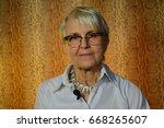 portrait of smiling caucasian... | Shutterstock . vector #668265607
