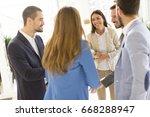 business partners analyze the... | Shutterstock . vector #668288947