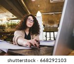 young woman working in the... | Shutterstock . vector #668292103