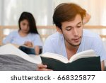 couple reading a book together... | Shutterstock . vector #668325877