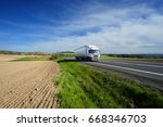 white truck driving on the road ...   Shutterstock . vector #668346703
