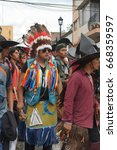Small photo of COTACACHI, ECUADOR - JUNE 24, 2017: Man in an American Indian costume in the men's parade in Inti Raymi, the indigenous solstice celebration, with a history of violence