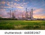 oil refinery at twilight | Shutterstock . vector #668381467