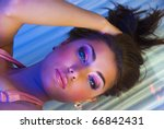 portrait of lying beauty girl at solarium - stock photo